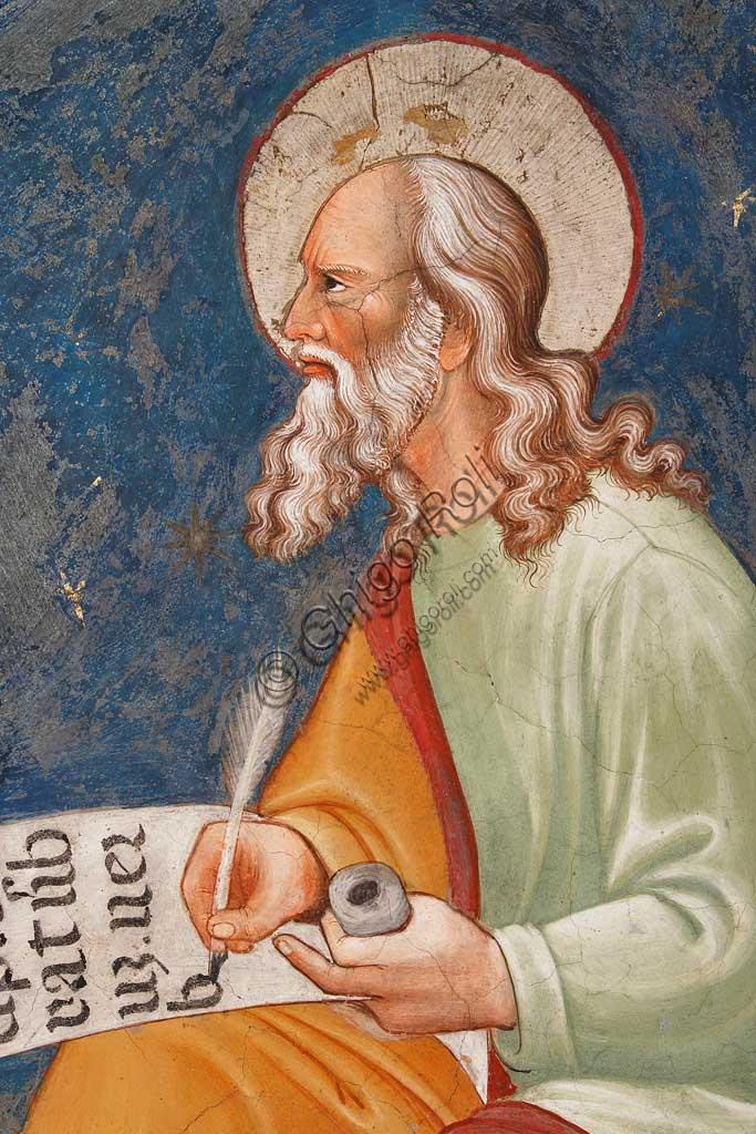 """Rocca di Vignola, Cappella Contrari, parete orientale: """"S. Giovanni Evangelista"""" che scrive """"In principio erat Verbum"""". Affresco del Maestro di Vignola, anni Venti del Quattrocento.  Particolare."""
