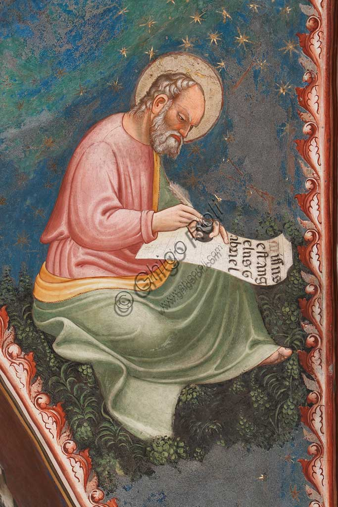 "Vignola Stronghold, the Contrari Chapel, Northern wall: ""St. Luke Evangelist"", writing "" Missus est angelus Gabriel"". Fresco by the Master of Vignola, about 1420."