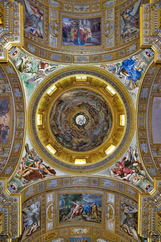 """Basilica of St Andrew della Valle: the transept  ceiling with the pendentives and the dome. In the pendentives, frescoes of the four evangelists, by Domenichino (Domenico Zampieri), 1622 - 28. In the dome vault, """"Glory of the Paradise"""", fresco by Giovanni Lanfranco, 1625 - 28."""