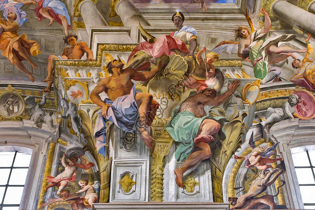 """Rome, S. Ignazio Church, interior: detail of one of the pendentives of the vault of the nave with allegories of the continents: """"Africa"""", fresco by Andrea Pozzo, 1685."""