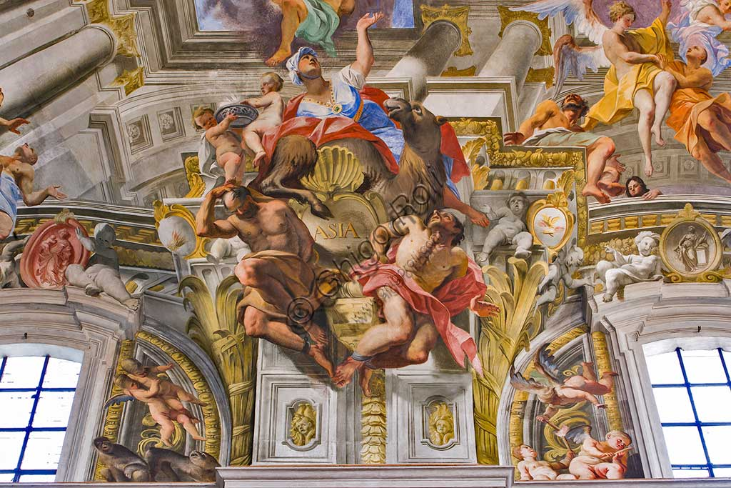 """Rome, S. Ignazio Church, interior: detail of one of the pendentives of the vault of the nave with allegories of the continents: """"Asia"""", fresco by Andrea Pozzo, 1685."""