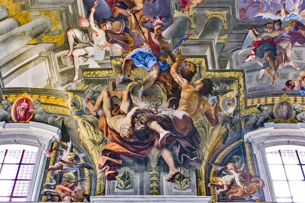 """Rome, S. Ignazio Church, interior: detail of one of the pendentives of the vault of the nave with allegories of the continents: """"America"""", fresco by Andrea Pozzo, 1685."""