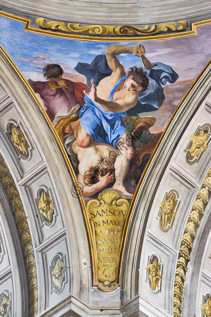 """Rome, S. Ignazio Church, interior: detail of one of the pendentives of the false dome of the transept: """"Samson slaying a thousand Philistines with the jawbone of a donkey """", fresco by Andrea Pozzo, 1685."""