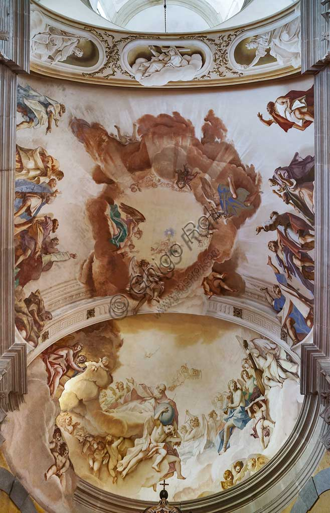 "Basilica of S. Giustina, Chapel of the Blessed Sacrament: the basin of the apse and the vault. In the apsidal basin: ""God among angels and apostles"",  the basin of the apse takes light from an opening hidden behind one of the figures It is an  extraordinary scenographic effect,which is typical of the Baroque. In the vault, ""Apostles in adoration of the Eucharist and Trinity"". Frescoes by Sebastiano Ricci."
