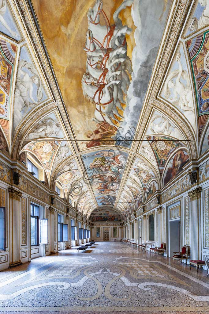"Mantua, Palazzo Ducale (Ducal Palace),The Ducal Apartment: view of the Hall of the Mirrors (formerly the Great Gallery). In the vault: ""Apollo (Helios) leading the chariot of the Sun"" and ""Gathering of the Gods of Olympus"". Frescoes by Carlo Santner, 1618."
