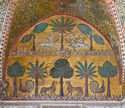Palermo, The Royal Palace or Palazzo dei Normanni (Palace of the Normans), Pisana Tower,  the King Roger Room: view of the Room which was commissioned by King Roger II d'Altavilla. It is characterized by large mosaic surfaces of great value representing plant elements  and scenes of courtly and hunting style, symbols of the Norman power (hunting scenes with archers and deer, peacocks, swans, and mythological centaurs, griffins and other exotic animals  among luxuriant vegetation). Mosaics are characterised by Greek Byzantine style (XIII century).Detail with centaurs, peacocks, leopards and palm and banana trees.