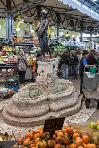 Modena, market in Albinelli street (the market was built in 1931 according to art nouveau style): statue of young girl with fruit basket, by Giuseppe Graziosi.