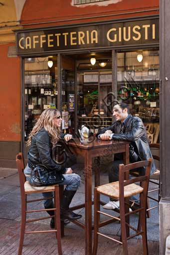 "Modena, ""Caffetteria Giusti"" (coffee house/bar) in Farini street: couple at a bar table."
