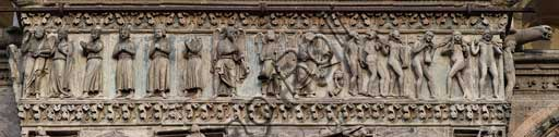 "Ferrara, the Cathedral dedicated to St. George, façade: detail of the tympanum and the trabeation with the ""Last Judgement""."