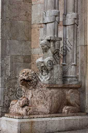 Ferrara, the Cathedral dedicated to St. George, façade: detail with lion and telamon supporting the prothyrum.