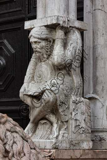Ferrara, the Cathedral dedicated to St. George, façade: detail with telamon supporting the prothyrum.