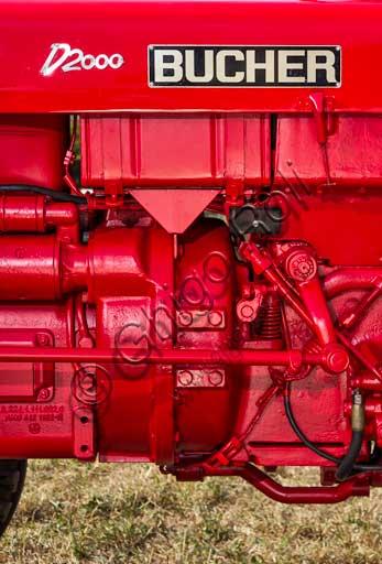 Trattore d'epoca. Particolare.Marca: BucherModello: D- 2000Anno: 1962Alimentazione: gasolioNumero cilindri: 2Cilindrata: 2.000 ccPotenza: CV 28Caratteristiche: Motore MWM, con barra falciante e macchina per imballare il fieno