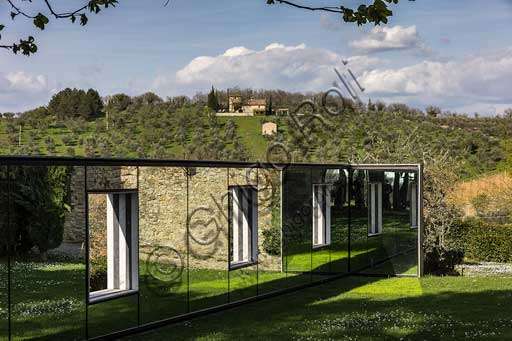 Gaiole in Chianti, Castello di Ama (Ama Castle): partial view of the area dedicated to contemporary art and view of the surrounding hills with olive trees and farmhouse.