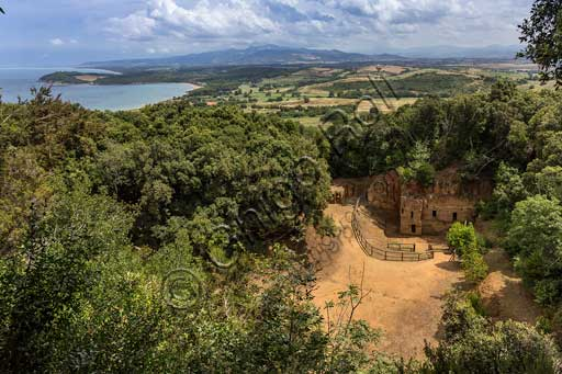 The Archaeological Park of Baratti and Populonia, Necropolis of St. Cerbone in Baratti, Via delle Cave (the Road of the Quarries): Necropolis of the Quarries. In the background, the Baratti Gulf.