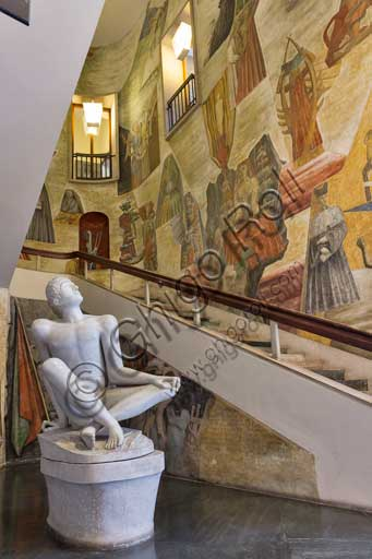 "Padua, University, Palazzo Bo: the Atrium of Heroes ( dedicated to students fallen in the wars from 1848 to 1866, and  fallen during the Italian Resistance Movement). There is a  statue (1946-1947) by Arturo Martini representing Palinuro, the helmsman of Aeneas, who died in view of Italy.The design of the stair and the decoration of the walls are by Gio Ponti. The frescoes ""The humanity and culture"" (1941) depict  the birth and development of humanity, culture and sciences."