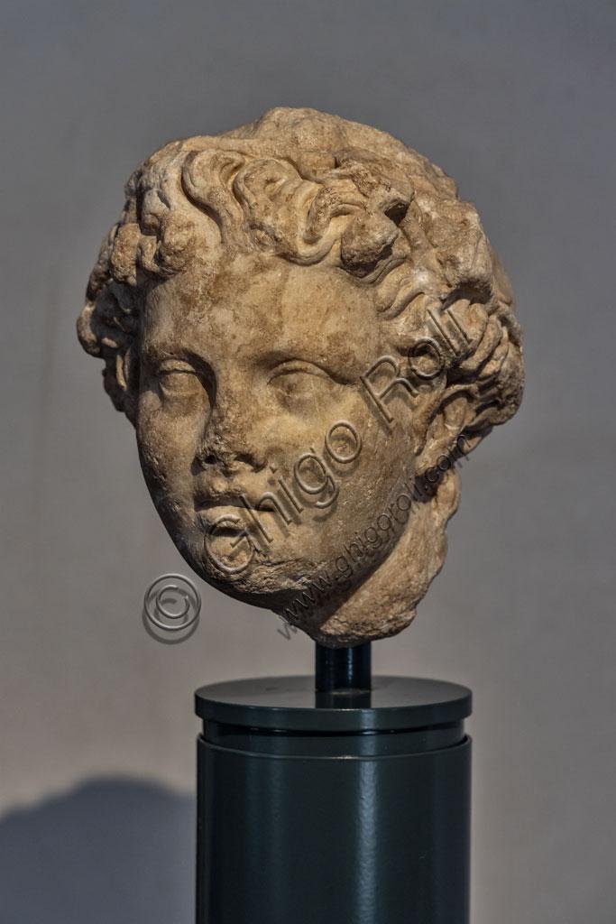 """Brescia, """"Santa Giulia, Museo della Città"""" (sito Unesco dal 2011): scultura romana che rappresenta la testa di un giovinetto."""