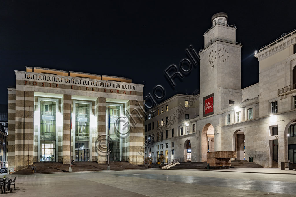 Brescia: night view of piazza della Vittoria (square built between 1927 and 1932) designed by the architect and urban planner Marcello Piacentini. From the left, the Post Office Palace and the Tower of Revolution.
