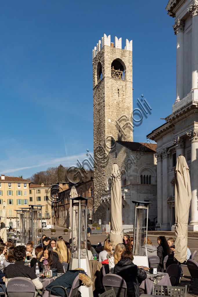 Brescia, Paolo VI Square: from the left, the Broletto with the Pégol Tower and the Loggia delle Grida;  the Duomo Nuovo  (the New Cathedral) , in late Baroque style with the facade of Botticino marble.