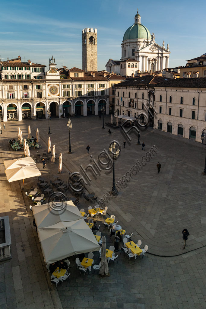 Brescia, piazza della Loggia (a Renaissance square where the Venetian influence is evident):  view. In the background, from the leftthe Clock Tower, the Pégol Tower and the dome of the New Duomo.
