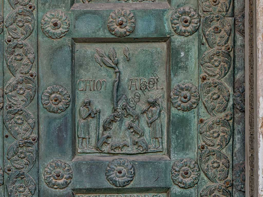 """Monreale Cathedral, the gate by Bonanno Pisano (1185-6): bronze tile depicting """"Cain and Abel"""" (scene of the Old Testament).The gate is signed """"Bonanno civis pisanus"""". It depicts five scenes of the Old Testament at the bottom, starting with Adam and Eve, and five scenes of the New Testament at the top, ending in """"Christ and Mary in the glory of Paradise""""."""