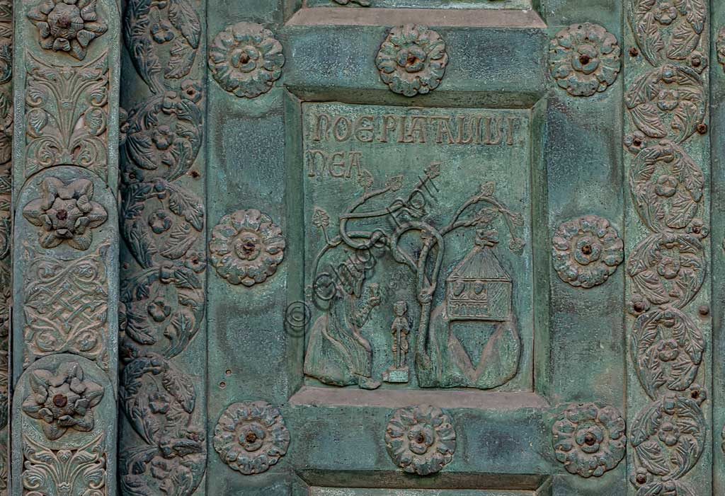 """Monreale Cathedral, the gate by Bonanno Pisano (1185-6): bronze tile depicting """"Noah cultivating the Vineyard"""" (scene of the Old Testament).The gate is signed """"Bonanno civis pisanus"""". It depicts five scenes of the Old Testament at the bottom, starting with Adam and Eve, and five scenes of the New Testament at the top, ending in """"Christ and Mary in the glory of Paradise""""."""