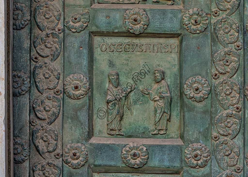 "Monreale Cathedral, the gate by Bonanno Pisano (1185-6): bronze tile depicting ""Two Prophets: Isaiah and Hosea"" (scene of the Old Testament).The gate is signed ""Bonanno civis pisanus"". It depicts five scenes of the Old Testament at the bottom, starting with Adam and Eve, and five scenes of the New Testament at the top, ending in ""Christ and Mary in the glory of Paradise""."