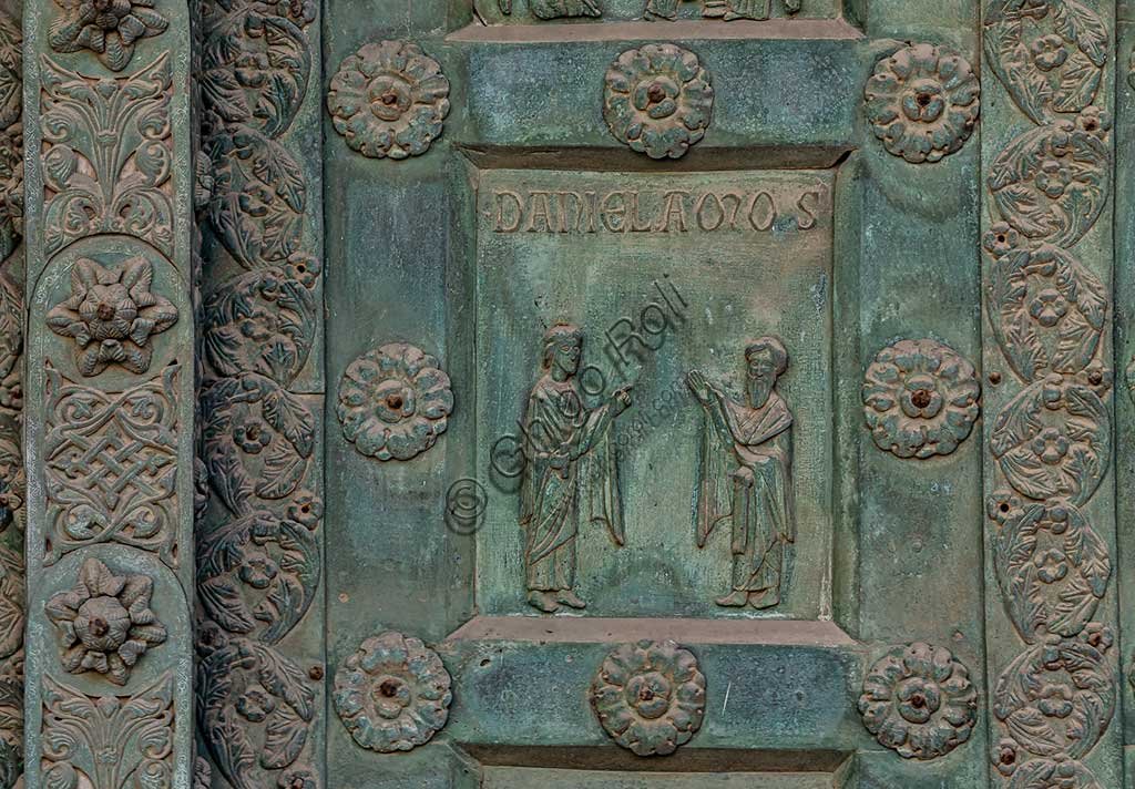 """Monreale Cathedral, the gate by Bonanno Pisano (1185-6): bronze tile depicting """"Two Prophets: Daniel and Amos"""" (scene of the Old Testament).The gate is signed """"Bonanno civis pisanus"""". It depicts five scenes of the Old Testament at the bottom, starting with Adam and Eve, and five scenes of the New Testament at the top, ending in """"Christ and Mary in the glory of Paradise""""."""