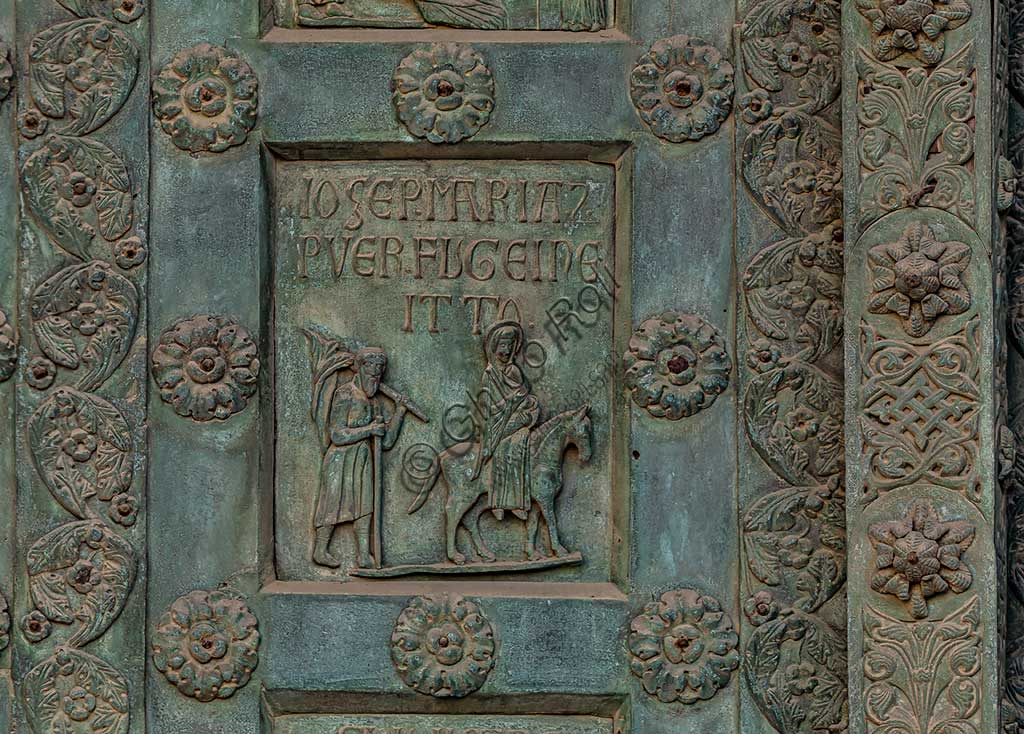 """Monreale Cathedral, the gate by Bonanno Pisano (1185-6): bronze tile depicting """"Annunciation"""" (scene of the New Testament).The gate is signed """"Bonanno civis pisanus"""". It depicts five scenes of the Old Testament at the bottom, starting with Adam and Eve, and five scenes of the New Testament at the top, ending in """"Christ and Mary in the glory of Paradise""""."""
