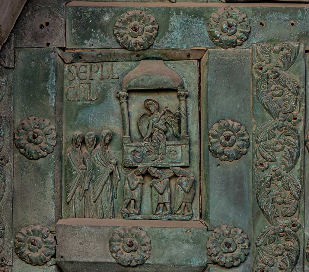 """Monreale Cathedral, the gate by Bonanno Pisano (1185-6): bronze tile depicting """"The Resurrection at the Sepulchre"""" (scene of the New Testament).The gate is signed """"Bonanno civis pisanus"""". It depicts five scenes of the Old Testament at the bottom, starting with Adam and Eve, and five scenes of the New Testament at the top, ending in """"Christ and Mary in the glory of Paradise""""."""