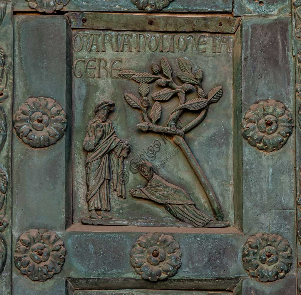 """Monreale Cathedral, the gate by Bonanno Pisano (1185-6): bronze tile depicting """"Noli Me Tangere"""" (scene of the New Testament).The gate is signed """"Bonanno civis pisanus"""". It depicts five scenes of the Old Testament at the bottom, starting with Adam and Eve, and five scenes of the New Testament at the top, ending in """"Christ and Mary in the glory of Paradise""""."""
