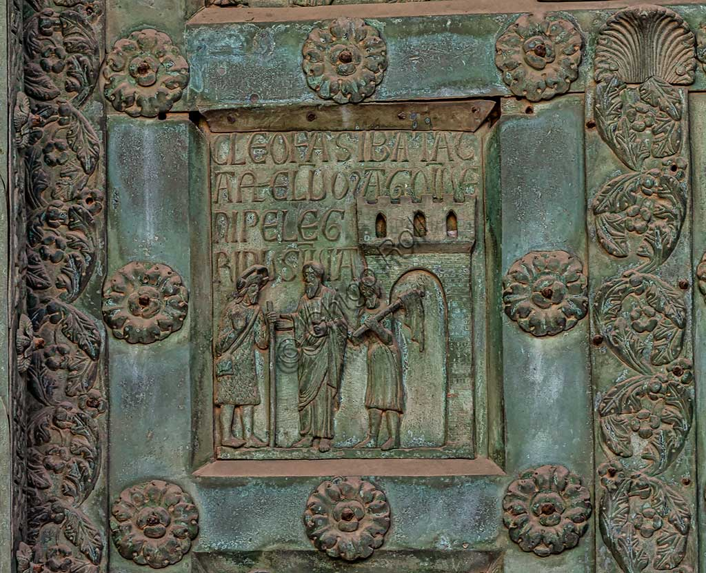 """Monreale Cathedral, the gate by Bonanno Pisano (1185-6): bronze tile depicting """"Supper in Emmaus"""" (scene of the New Testament).The gate is signed """"Bonanno civis pisanus"""". It depicts five scenes of the Old Testament at the bottom, starting with Adam and Eve, and five scenes of the New Testament at the top, ending in """"Christ and Mary in the glory of Paradise""""."""