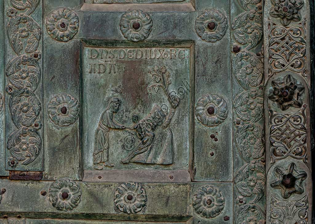 """Monreale Cathedral, the gate by Bonanno Pisano (1185-6): bronze tile depicting """"The creation of Eve"""" (scene of the Old Testament).The gate is signed """"Bonanno civis pisanus"""". It depicts five scenes of the Old Testament at the bottom, starting with Adam and Eve, and five scenes of the New Testament at the top, ending in """"Christ and Mary in the glory of Paradise""""."""